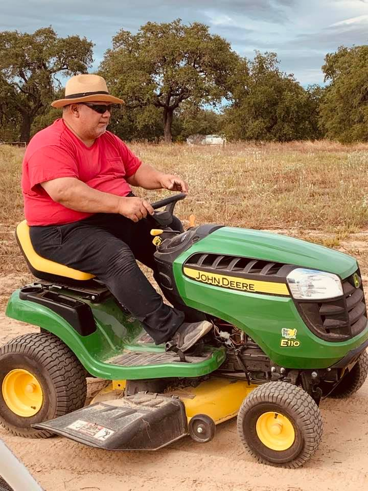 David of David's Garden Seeds® zipping along on his little tractor across the farm. He is having a blast!