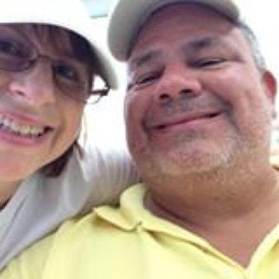 Juanita (Mrs. David's Garden Seeds®) and David of David's Garden Seeds® working in their first store five years ago.
